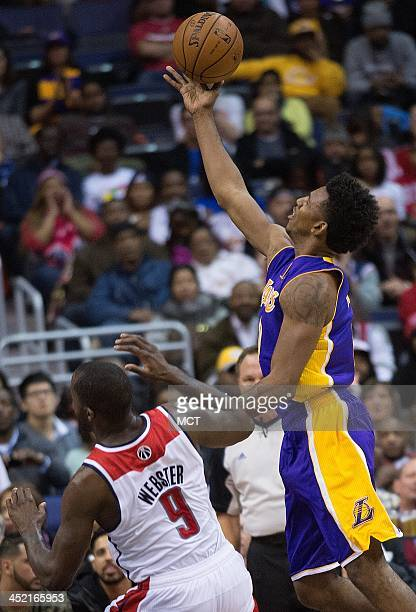 Los Angeles Lakers small forward Nick Young shoots over Washington Wizards small forward Martell Webster during the second half of their game played...