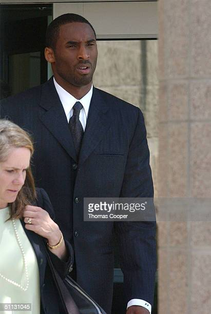 Los Angeles Lakers star Kobe Bryant along with his attorney Pamela Mackey leave the Eagle County Justice Center after pretrial hearings July 30 2004...