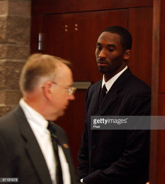 Los Angeles Lakers star Kobe Bryant along with security Ed Kilam leave the Eagle County Justice Center courtroom July 30 2004 in Eagle Colorado On...