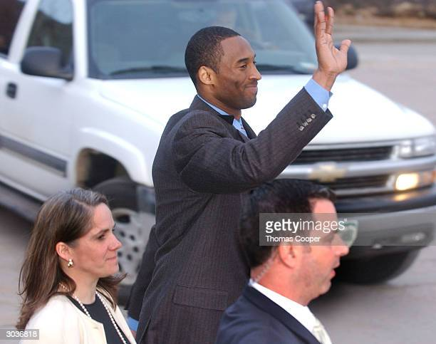 Los Angeles Lakers star Kobe Bryant and attorney Pam Mackey react to local area kids who where holding signs proclaiming Bryant's innocence March 2...