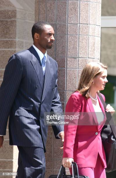 Los Angeles Lakers star Kobe Bryant and his attorney Pamela Mackey leave for a lunch break at the Eagle County Courthouse July 19 2004 in Eagle...