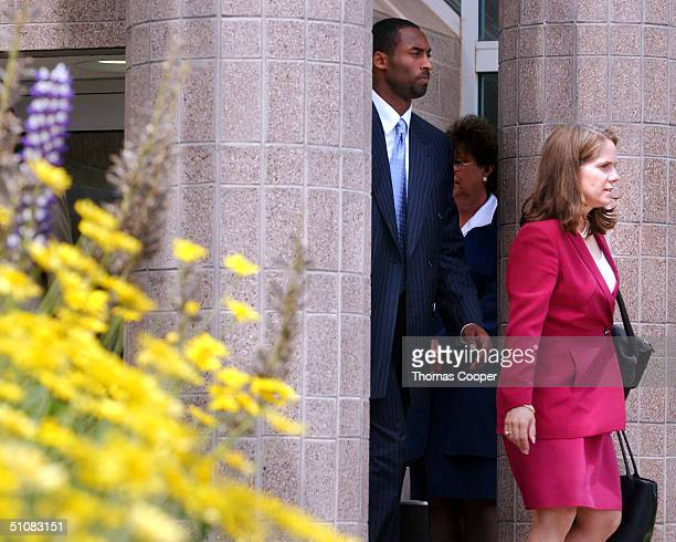 Los Angeles Lakers star Kobe Bryant and his attorney Pamela Mackey leave the Eagle County Justice Center after a day of pretrial hearings July 19...