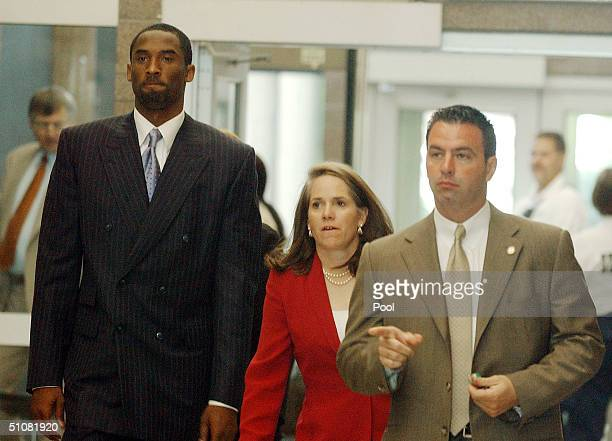 Los Angeles Lakers star Kobe Bryant arrives with his attorney Pamela Mackey at the Eagle County Courthouse July 19 2004 in Eagle Colorado Lawyers for...