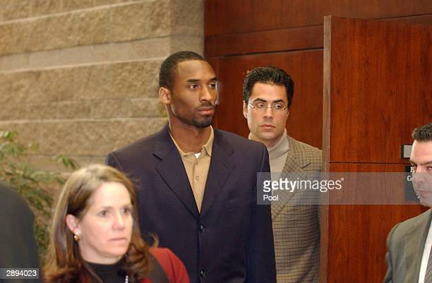 Los Angeles Lakers star Kobe Bryant enters the courtroom accompanied by his attorney Pamela Mackey at the Eagle County Justice Center January 23 2004...