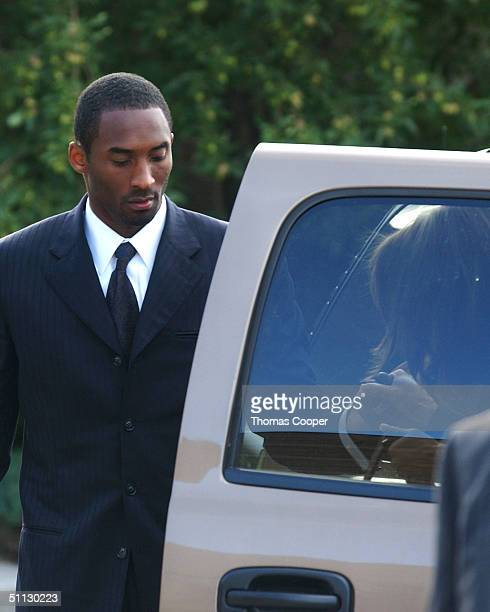 Los Angeles Lakers star Kobe Bryant helps his attorney Pamela Mackey out of the SUV as they arrive at the Eagle County Justice Center for pretrial...