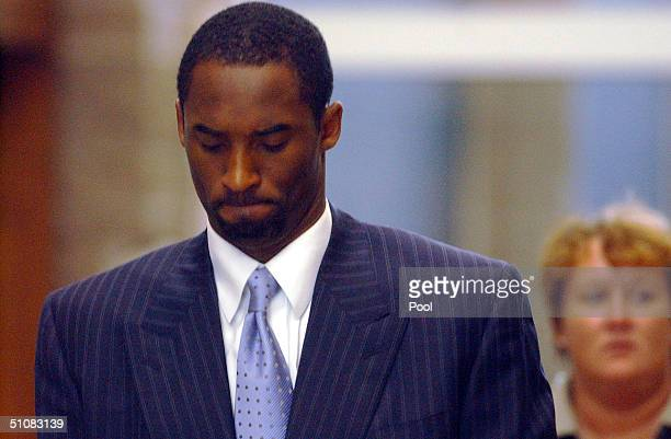Los Angeles Lakers star Kobe Bryant leaves the Eagle County Justice Center after a day of pretrial hearings July 19 2004 in Eagle Colorado Kobe is to...