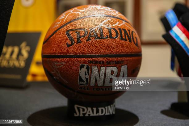 Los Angeles Lakers team signed basketball is displayed at a press preview for sports legends featuring Kobe Bryant, FIFA and Olympic Medals at...