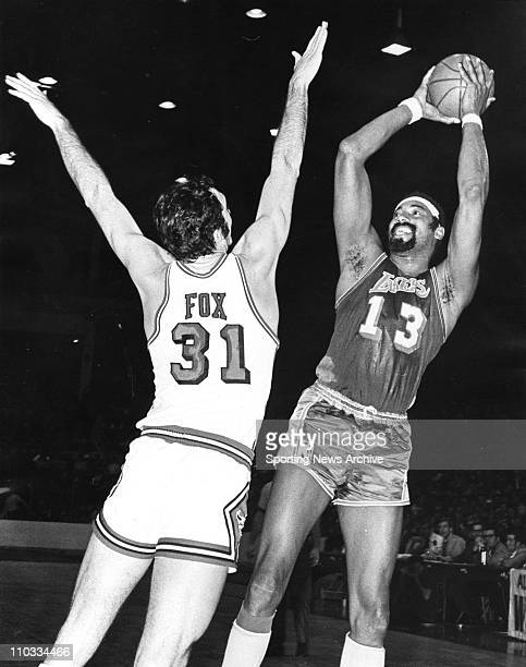 Los Angeles Lakers Wilt Chamberlain shoots over Chicago Bulls Jim Fox on Feb 14 1971