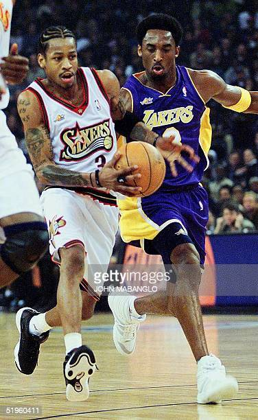 Los Angeles Lakes Kobe Bryant scrambles after Philadelphia 76er Allen Iverson during 1st quarter action of the NBA AllStar EastWest game at the Arena...