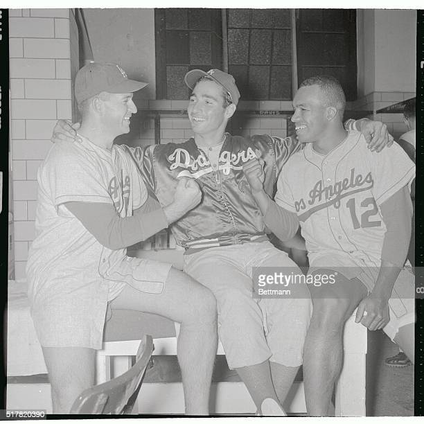 Los Angeles lefthander Sandy Koufax who beat the Pittsburgh Pirates 10 on a wonhitter 5/23 is congratulated by his teammates who gave him the lone...