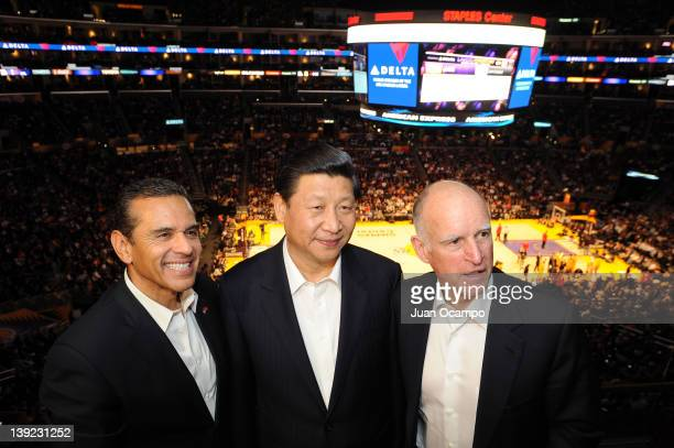 Los Angeles Mayor Antonio Villaraigosa Chinese Vice President Xi Jinping and California Governor Jerry Brown pose for a photograph during a game...