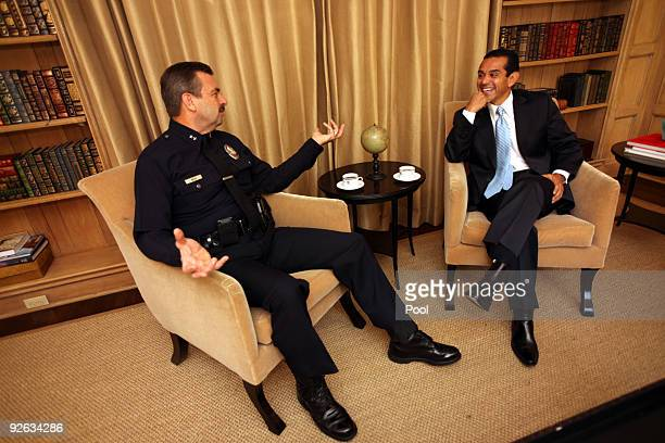 Los Angeles Mayor Antonio Villaraigosa speaks with Deputy LAPD Chief Charlie Beck as they enjoy coffee and chat together at Getty House; the Mayors...