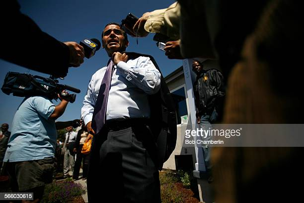 Los Angeles Mayor Antonio Villaraigosa talks to the media after he toured a renovated house at 903 W 66th St that is part of a Los Angeles Housing...