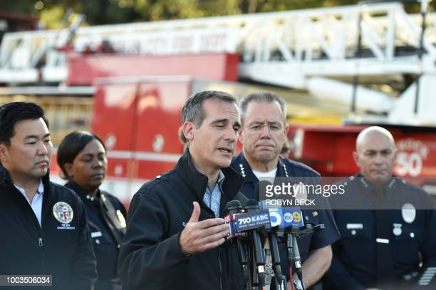 Los Angeles Mayor Eric Garcetti addresses the press after a suspect barricaded inside a Trader Joe's supermarket in Silverlake Los Angeles on July 21...