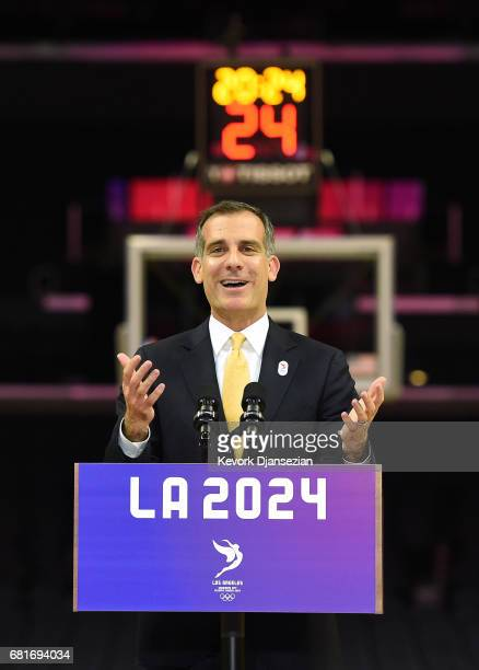 Los Angeles Mayor Eric Garcetti and LA 2024 Chairman Casey Wasserman hold a news conference on the Los Angeles Lakers' hard court floor inside...