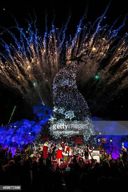 Los Angeles Mayor Eric Garcetti and actors Alexa PenaVega Carlos PenaVega and Yvette Nicole Brown attend Universal Studios Hollywood Grinchmas...