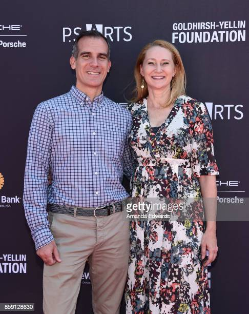 Los Angeles Mayor Eric Garcetti and Amy Wakeland arrive at PS ARTS' Express Yourself 2017 at Barker Hangar on October 8 2017 in Santa Monica...