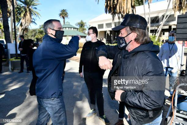 Los Angeles Mayor Eric Garcetti and CORE chairperson Sean Penn visit a coronavirus vaccination site at Lincoln Park on December 30, 2020 in Los...