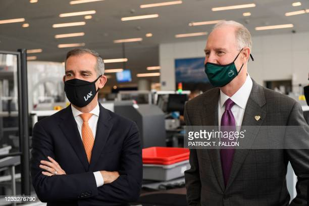 Los Angeles Mayor Eric Garcetti and Gary Kelly, chief executive officer of Southwest Airlines Co., tour a Transportation Security Administration...