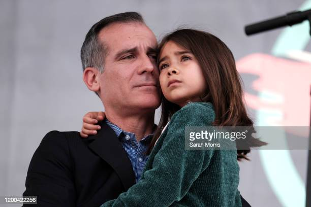Los Angeles Mayor Eric Garcetti and his daughter participate in the 4th Annual Women's March LA Women Rising at Pershing Square on January 18 2020 in...