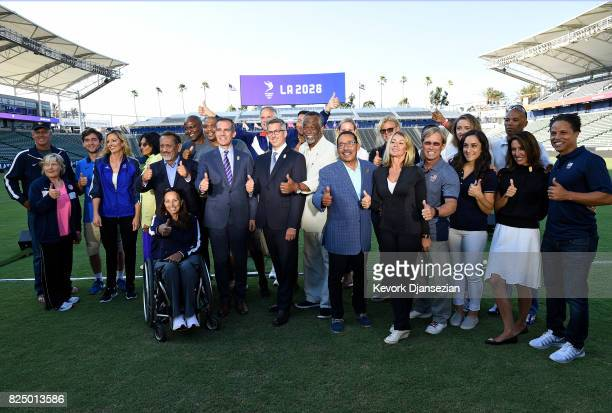 Los Angeles Mayor Eric Garcetti and memers of the LA 2024 bid committee pose for pictures after announcing a deal has been reached with the...