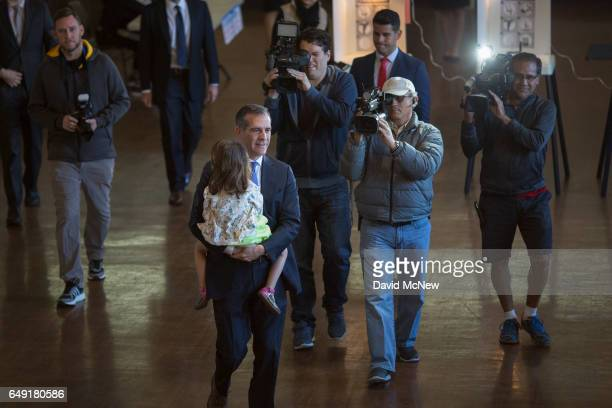 Los Angeles Mayor Eric Garcetti arrives to vote with daughter Maya Garcetti as Angelenos go to the polls on March 7 2017 in Los Angeles California...