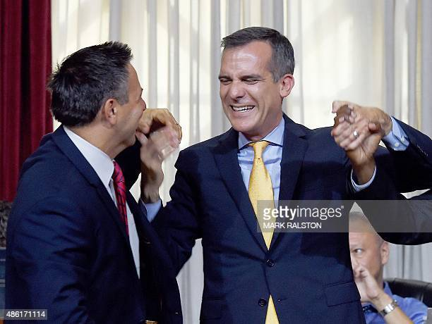 Los Angeles Mayor Eric Garcetti celebrates with Los Angeles City Councilman Joe Buscaino after the council voted to bid for the 2024 Summer Olympics...