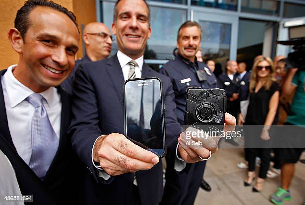 Los Angeles Mayor Eric Garcetti center with Councilmember Mitch Englander left and LAPD Chief Charlie Beck right show the new LAPD body camera right...