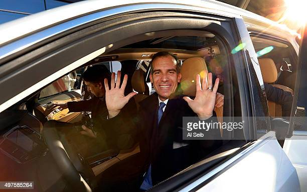 LOS ANGELES CA NOVEMBER 17 2015 Los Angeles Mayor Eric Garcetti demonstrated no hands as he arrives at the Connected Car Expo at the JW Marriott...