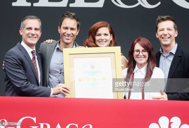 Los Angeles Mayor Eric Garcetti Eric McCormack Debra Messing Megan Mullally and Sean Hayes pose at the 'Will Grace' first day kick off of production...