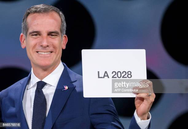 Los Angeles Mayor Eric Garcetti gets emotional as he holds a card bearing the name of LA 2028 after the vote during the 131st International Olympic...