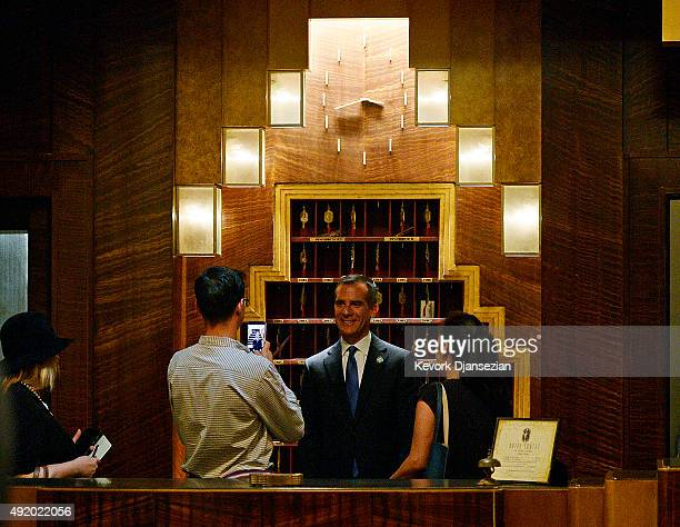 Los Angeles Mayor Eric Garcetti gets his souvenir photo taken by his staff at the reception desk of Hotel Cortez on the set of 'American Horror Story...