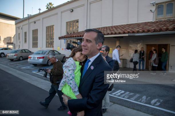 Los Angeles Mayor Eric Garcetti leaves his polling place with daughter Maya Garcetti after voting for mayor as Angelenos go to the polls on March 7...