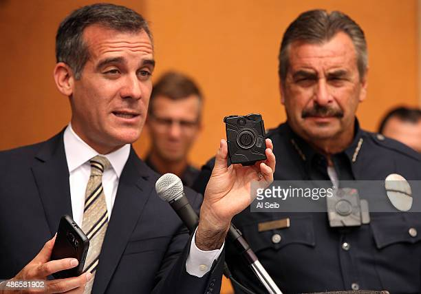Los Angeles Mayor Eric Garcetti left with LAPD Chief Charlie Beck right who is wearing a body camera shows the new LAPD body camera and cell phone...