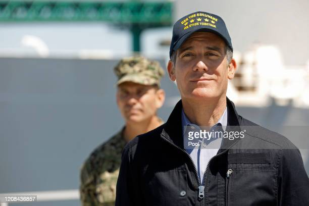 Los Angeles Mayor Eric Garcetti listens as California Governor Gavin Newsom speaks in front of the hospital ship USNS Mercy that arrived into the...