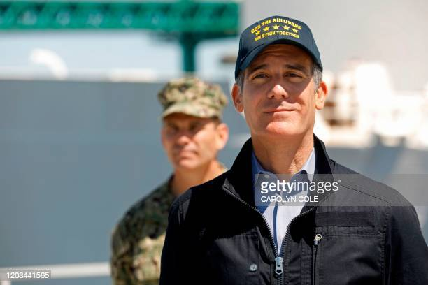 Los Angeles Mayor Eric Garcetti listens to the governor of California speak in front of the USNS Mercy hospital ship after it arrived into the Port...