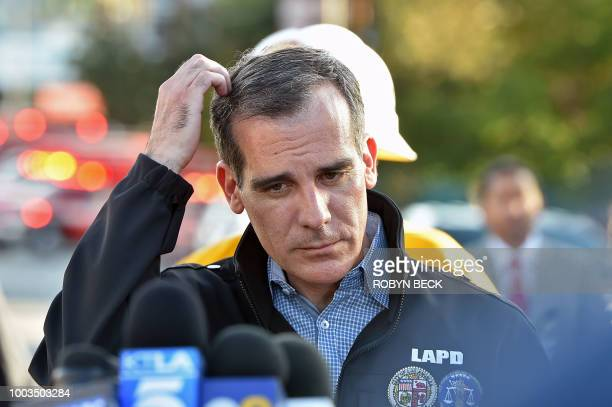 Los Angeles Mayor Eric Garcetti looks on before addressing the press after a suspect barricaded inside a Trader Joe's supermarket in Silverlake Los...