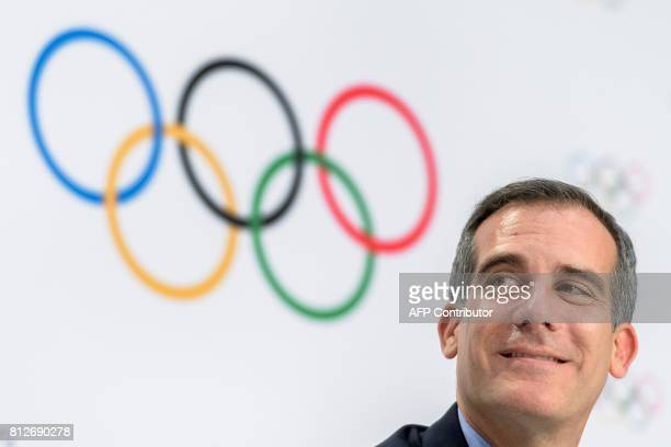 Los Angeles' Mayor Eric Garcetti looks on beneath the Olympic Rings during a press conference following an International Olympic Committee...