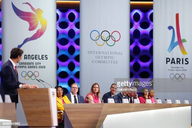 Los Angeles Mayor Eric Garcetti observes Paris 2024 Bid CoChair and 3time Olympic Champion Tony Estanguet during his presentation during the 131th...