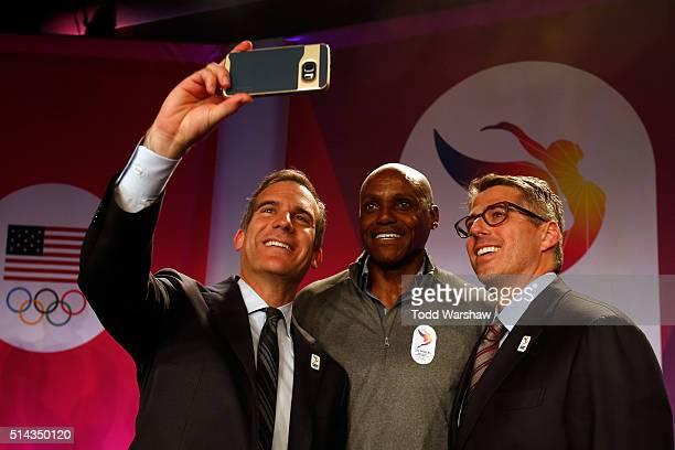 Los Angeles Mayor Eric Garcetti Olympian Carl Lewis and Casey Wasserman Chairman LA2024 address the media at the USOC Olympic Media Summit at The...