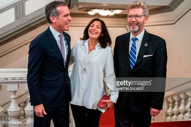 Los Angeles Mayor Eric Garcetti Paris Mayor Anne Hidalgo and Copenhagen Mayor Frank Jensen arrive at the Gala Dinner on the occasion of the World...