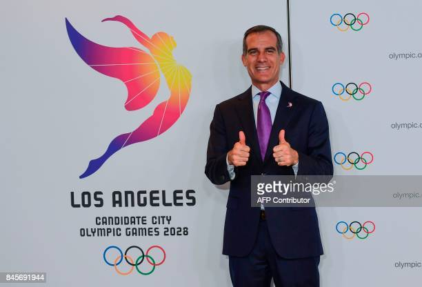 Los Angeles Mayor Eric Garcetti poses for pictures as the International Olympic Committee opens a week of highlevel meetings which will see Paris and...