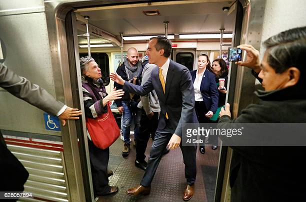 """Los Angeles Mayor Eric Garcetti says good bye to commuter Susan Rorke, left, who exclaimed """"You made my day, you made my day"""" as he visited with..."""
