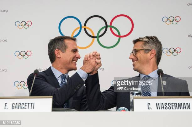 Los Angeles Mayor Eric Garcetti shakes hands with LA 2024 chaiman Casey Wasserman during a press conference after the Los Angeles 2024 bid...
