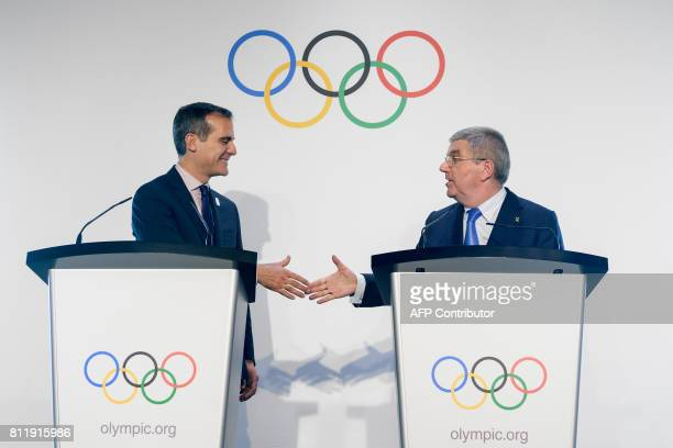 Los Angeles Mayor Eric Garcetti shakes hands with International Olympic Committee President Germany's Thomas Bach during their visit to the Olympic...