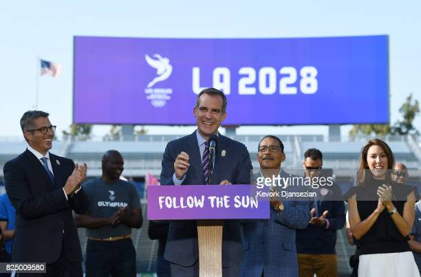 Los Angeles Mayor Eric Garcetti speaks at the podium as he announces a deal has been reached with the International Olympic Committee to host the...