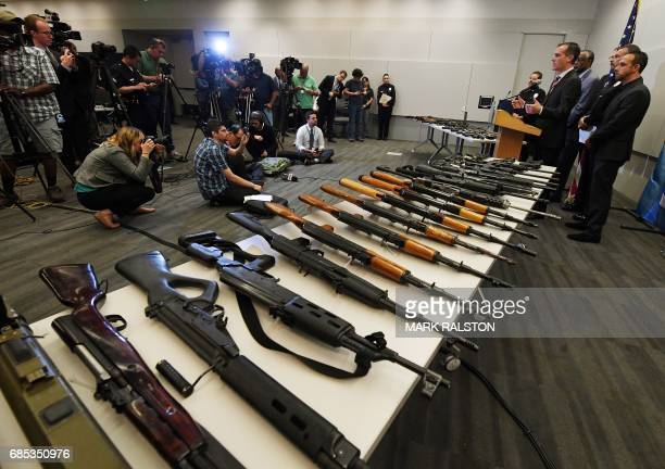 Los Angeles Mayor Eric Garcetti speaks to the media beside a batch of assault rifles and two rocket propelled grenade launchers at a press conference...