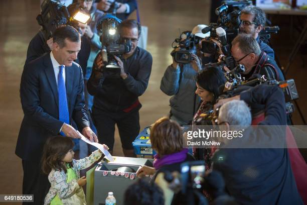 Los Angeles Mayor Eric Garcetti votes with daughter Maya Garcetti as Angelenos go to the polls on March 7 2017 in Los Angeles California Voters...