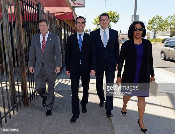 Los Angeles mayoral candidate and City Councilman Eric Garcetti walks along Hollywood Boulevard with three former mayoral candidates who have...