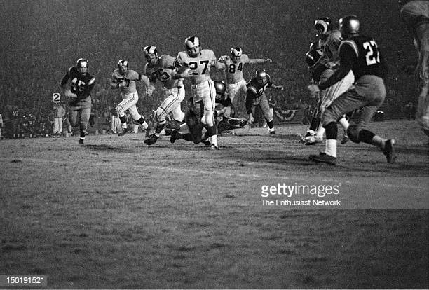 Los Angeles Memorial Coliseum. Night game. Los Angeles Times Twelfth Annual Football Game to benefit charity. Friday Night August 17, 1956.